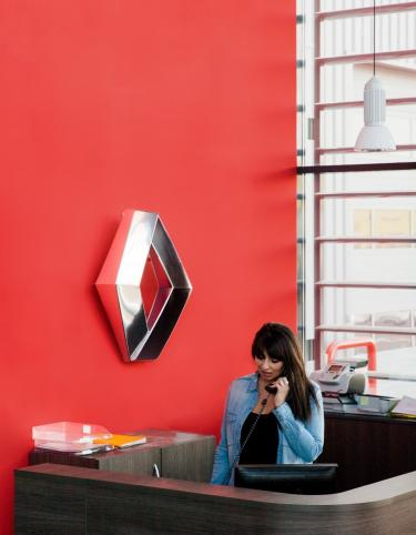 Woman on the phone in a Renault Trucks dealership